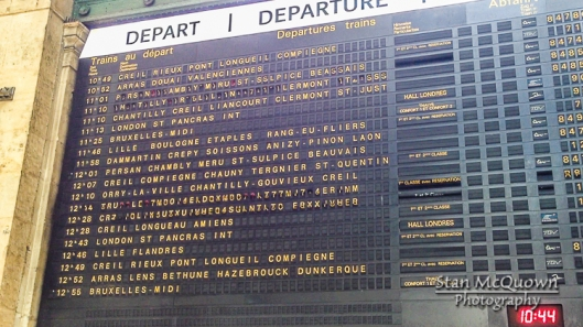 Watching the train schedule board at Gare du Nord.