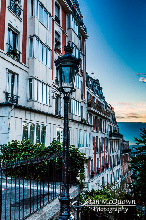 Street lamp and the stairs leading down Rue Muller at sunrise!