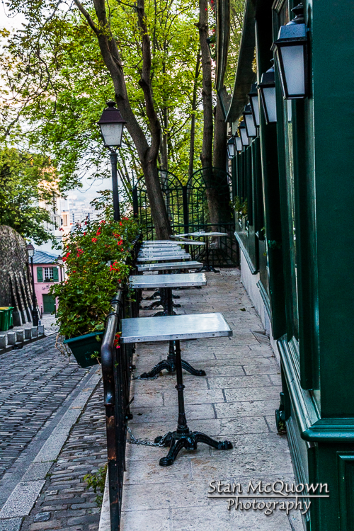 The side cafe seating of La Bonne Franquette looking down  Rue des Saules to La Masion Rose at the corner below!