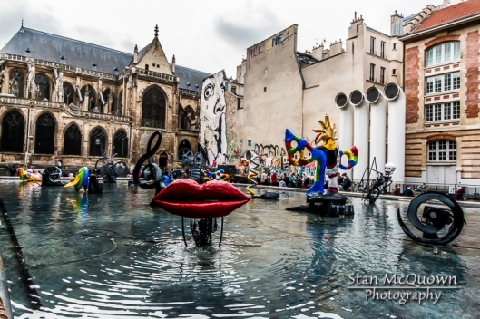 Fontaine Stravinsky and the Paroisse Saint Merry Church with some wall art and the air intake pipes for the George Pompidou Center!